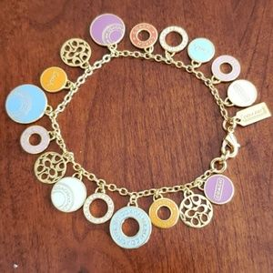 Coach gold tone charm bracelet with 18 charms